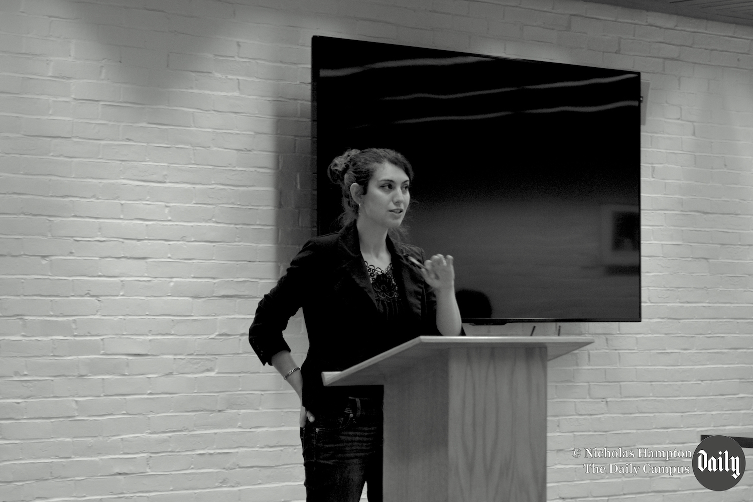A black and white photo showing Dr. LaGuardia-LoBianco delivering a talk at the UCHI Center at the University of Connecticut in Storrs, where she completed her graduate work